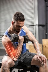 Determinated male athlete doing excercise with dumbbells