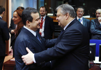 Greek Foreign Minister Venizelos greets Serbian PM Dacic during a EU-Serbia accession conference in Brussels