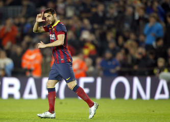 Barcelona's Cesc Fabregas celebrates a goal against Getafe during their Spanish King's Cup soccer match at Camp Nou stadium in Barcelona