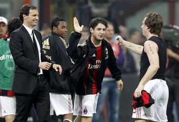 AC Milan's Cassano celebrates with temmate Pato and coach Allegri after scoring a penalty against Inter Milan during Italian Serie A soccer match in Milan