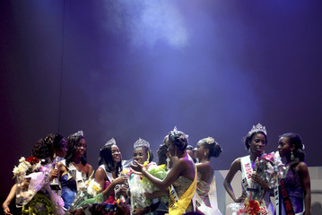 Contestants react after the results announcement during the Most Beautiful Girl in Nigeria (MBGN) 2010 beauty pageant in the commercial capital Lagos