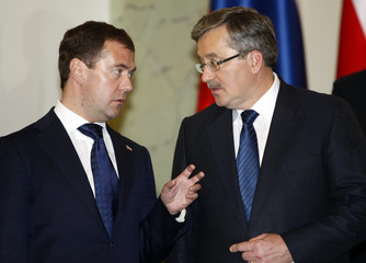 Russia's President Medvedev and Poland's President Komorowski gesture as they talk in Warsaw