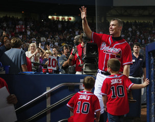 Braves third baseman Chipper Jones waves to fans after his MLB National League baseball game against the New York Mets at Turner Field in Atlanta.