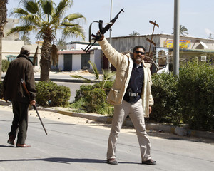 Gunmen opposed to leader Muammar Gaddafi man a checkpoint in the centre of the city of Zawiyah
