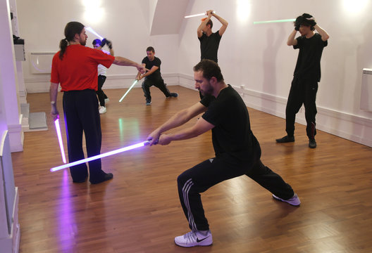 Members of the Sport Saber League practise light saber during a training session in Paris