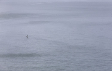 A paddleboarder is seen in the Irish Sea off the coast of Portrush in Northern Ireland