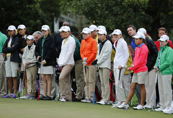 Girls line the green during the Drive Pitch and Putt contest before the Masters golf tournament at the Augusta National Golf Club