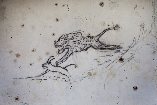 A drawing of a lion hunting an antelope is seen on the wall of the abandoned governor's mansion on the island of Bolama