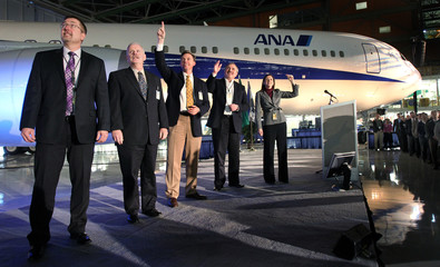 Boeing Commercial Airplanes Vice President and 767 jetliner program manager Pastega pumps her fist while watching video at ceremonial roll-out of 1,000th 767 jetliner in Washington