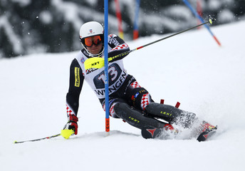 Zrncic-Dim of Croatia clears a gate during the slalom event of the men's World Cup super combined race in Wengen