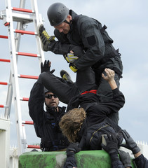 German riot police climbers remove anti-nuclear demonstrators during a blockade of the entrance of the nuclear power plant Brokdorf in Brokdorf