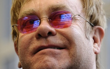 Britain's Elton John smiles during the morning conference at The Independent newspapers editorial offices in London
