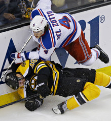 Boston Bruins Krejci's leg turns the wrong way after he was knocked down by New York Rangers del Zotto during Game 5 of their NHL Eastern Conference semi final hockey playoff game in Boston