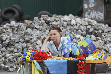 A street vendor sells items and gifts displaying Ukrainian national symbols at Independence Square in central Kiev