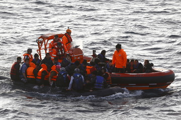 A Turkish Coast Guard fast rigid-hulled inflatable boats tow refugees and migrants in a dinghy on the Turkish territorial waters of the North Eagean sea, following a failed attempt of crossing to the Greek island of Lesbos, off the shores of Canakkale