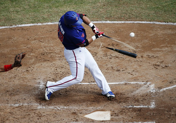 Chen breaks a bat on a fly out at the second inning during the semi-final baseball match against Japan  at the Munhak Baseball Stadium during the 17th Asian Games in Incheon