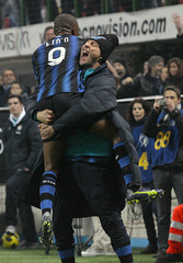 Inter Milan's Eto'o celebrates with his teammate Materazzi after scoring against AS Roma during their Italian Serie A soccer match in Milan