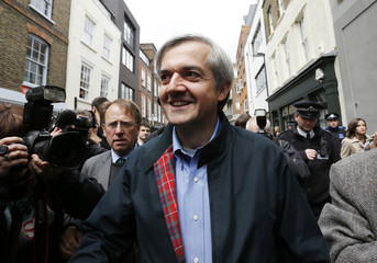 Former British cabinet minister Chris Huhne arrives back at his home, after being released from prison, in London