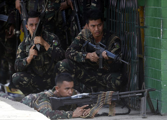 Government soldiers battling Moro National Liberation Front rebels take up positions in downtown Zamboanga city