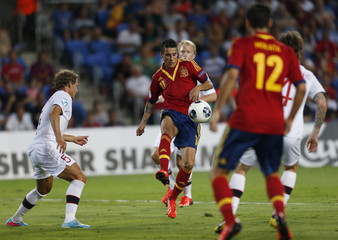 Cristian Tello of Spain fights for the ball with Vegar Hedenstad of Norway during their semi-final European Under-21 Championship soccer match in Netanya