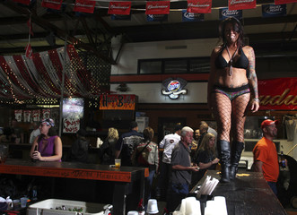 A beer girl dances for customers and tips at Suck Bang Blow biker bar in Murrells Inlet