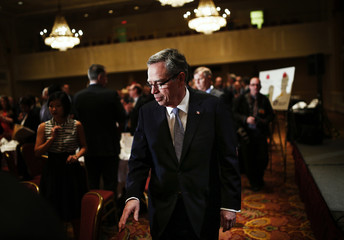 Oliver arrives to make first speech as Canada's new Finance Minister to economic community in Toronto
