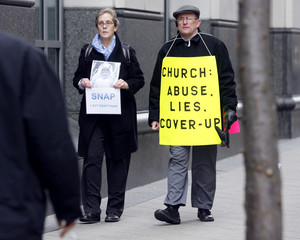 Clergy abuse advocates Hoatson and Dorris walk near the courthouse before a hearing on the Archdiocese of Philadelphia sexual abuse scandal in Philadelphia Pennsylvania