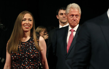 Chelsea Clinton and her father, former U.S. president Bill Clinton, arrive for the third and final debate between Republican U.S. presidential nominee Donald Trump and Democratic nominee Hillary Clinton in Las Vegas