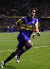 Pablo Mouche of Argentina's Boca Juniors celebrates after he scored a goal against of Brazil's Fluminense in their Copa Libertadores soccer match in Buenos Aires