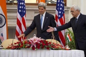 U.S. Secretary of State Kerry and Indian Minister of Foreign Affairs Khurshid take their seats before news conference at Hyderabad House in New Delhi