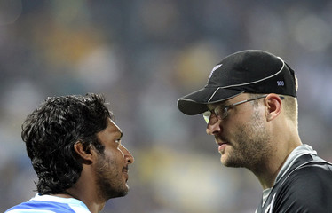 Sri Lanka's captain and wicketkeeper Sangakkara speaks with New Zealand's captain Vettori after Sri Lanka won their ICC Cricket World Cup 2011 semi-final match in Colombo