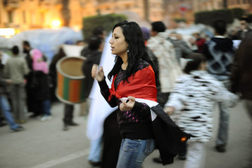 Protesters walk through mass demonstrations inside inside Tahrir Square in Cairo