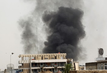 Smoke rises after a car bomb attack in the Karrada neighborhood in Baghdad