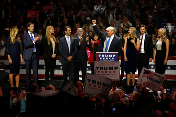 Trump, Pence and their families rally with supporters at an arena in Manchester, New Hampshire