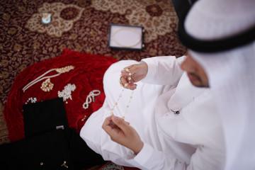 Mohammed al-Suwaidi, marketing manager at RAK Pearls, displays pearl jewellery at RAK's oyster farm off the coast of Ras Al Khaimah, one of the seven emirates that make up the United Arab Emirates
