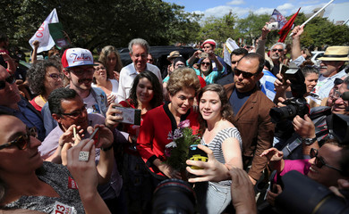 Brazil's former President Dilma Rousseff arrives to vote during municipal elections in Porto Alegre