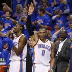 Oklahoma City Thunder's Durant and Westbrook celebrate after a shot against Memphis Grizzlies during their NBA basketball playoffs in Oklahoma City