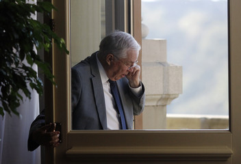 National Councillors Christoph Blocher using his mobile phone outside the National Council during an extraordinary Parliament Session in Bern