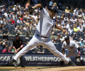 Yankees starting pitcher Pettitte throws a pitch to the Mariners in the fifth inning of their MLB American League baseball game at Yankee Stadium in New York