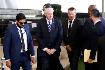 Former U.S. President Bill Clinton is seen upon his arrival to Mount Herzl Cemetery to attend the funeral of former Israeli President Shimon Peres, in Jerusalem