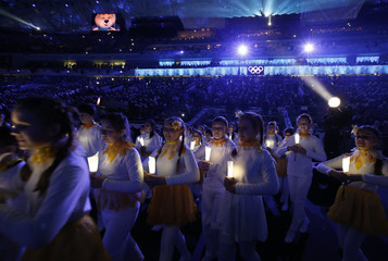 Performers take part in the closing ceremony for the Sochi 2014 Winter Olympic Games