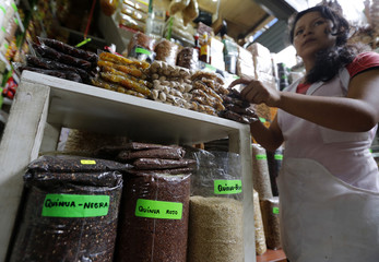 Woman sells Quinoa and other products at a market in Lima's Surquillo district