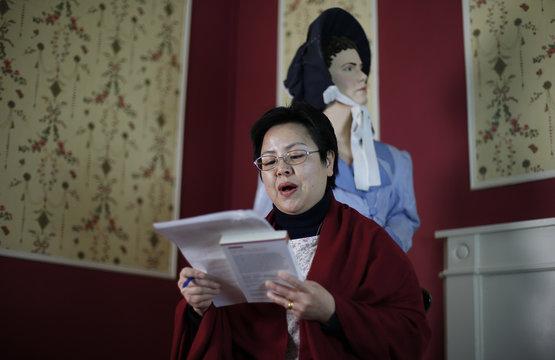 "Linguist Dan Li Dunford reads a Mandarin translation from Jane Austen's novel ""Pride and Prejudice"" during a twelve hour live readathon at the Jane Austen Centre in Bath"