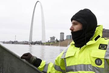 U.S. Geological Survey (USGS) hydro technician Jason Carron assessing the Mississippi River flood waters in St. Louis, Missouri