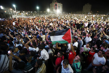 """Supporters cheer as """"Arab Idol"""" Mohammed Assaf performs in the West Bank city of Ramallah"""