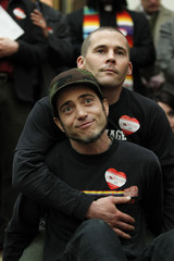Frank and his husband Joe Kapley-Alfano embrace during a press conference about the ruling of Proposition 8 banning gay marriage outside the Ninth Circuit Courthouse in San Francisco