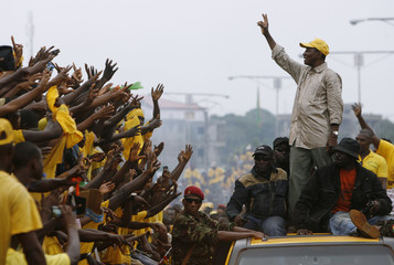 Guinea's presidential candidate Conde, leader of Rassemblement du Peuple de Guinea (RPG), gestures as he arrives for a presidential campaign rally in Conakry