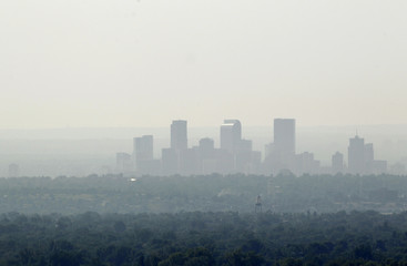 The downtown skyline of Denver, Colorado is obscured by smoke from the many wildfires burning in the state
