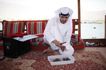 Mohammed al-Suwaidi, marketing manager at RAK Pearls, extracts the pearl from an oyster at RAK's oyster farm off the coast of Ras Al Khaimah, one of the seven emirates that make up the United Arab Emirates