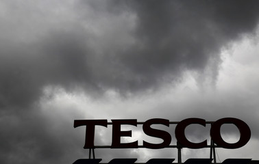 File photo of clouds over a Tesco Extra store in London